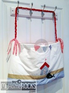 Cot bumper converted to storage/laundry bag, more ideas at: http://www.myhomerocks.com/2014/02/my-little-boys-bedroom-happy-nursery-decor-for-a-happy-baby/