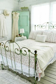 Shabby chic bedroom in refreshing shades of green and white.