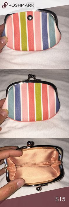 Coach Coin purse Like New!! Adorable stripped spring colored coin purse with hues of blue, coral, mossy green, and baby blue. Very dainty and cute little keeper for your coins! Coach Bags Wallets