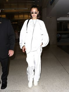 Jetting off: Bella Hadid was casually dressed as she prepared to catch a flight out of Los...