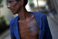 "Street sweeper Manuel Cruz, 52, wears a tattoo on his chest depicting Argentinean born Cuban revolution leader Ernesto ""Che"" Guevara in old Havana, Cuba, Wednesday, Aug. 15, 2012.  [Credit : Ramon Espinosa/AP]"