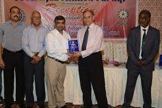 Proff. Ejaz Ahmed Farooqui President KCCA giving Shield to Saleem Karim