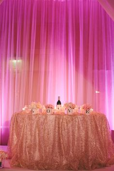 sweetheart table centerpiece, purple pink lighting,