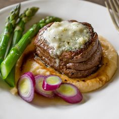 Easy to make Gorgonzola herb butter, melted atop a sizzling filet mignon. Served with rutabaga apple puree and asparagus.