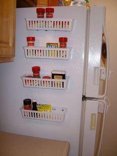 cheap baskets+ glue gun+ magnets= adjustable refrigerator organization- great idea!