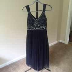 Navy blue formal beaded dress Navy blue formal mid-length silk dress. Beaded detail with sheer shirt. Size 6 great condition. Dresses Midi