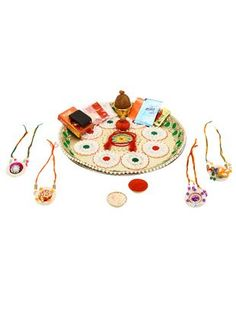 Check out what I found on the LimeRoad Shopping App! You'll love the Ethnic Style Handcrafted Designer Set of 4 Rakhis (With Decorative Thali & Pooja Samagri). See it here http://www.limeroad.com/products/11140854?utm_source=faf71db542&utm_medium=android