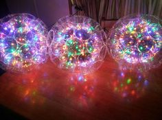 DIY Sparkle ball decorations made with clear solo cups. I actually made over a hundred of these things already. The trick is to hold the cups tightly together when you soldering them and wait till it cools. do it twice for each side connecting.