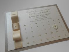 Save the date! Gorgeous calender save the date card with pretty pearl heart!