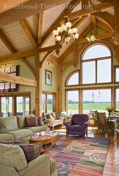 The timber frame is the star of this traditional great room.