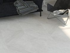 Premium quality stone effect grey tiles with subtle veining throughout, beautifully suited to contemporary style bathrooms, kitchens and living areas. Contemporary Style Bathrooms, Grey Tiles, Porcelain Tiles, Underfloor Heating, Light Texture, Bathroom Styling, Gray Background, Kitchen Living