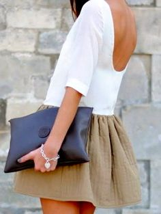 love the solid colors. navy clutch and tan skirt perfect.