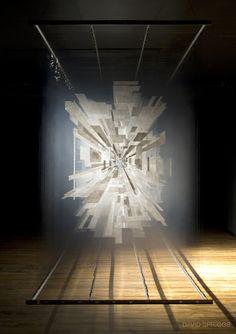 """Holocene"" (2011), by David Spriggs. Acrylic on layered transparent film, metal bar, springs, lights. Installation premiere at the Prague Biennale 5, Prague, Czech Republic. More info: www.davidspriggs.com/holocene/"