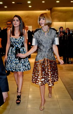 I may be torn about her, but boy, that's a great dress. Anna Wintour