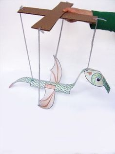 This dragon marionette puppet is a simple and fun craft for kids. It only requires a few supplies to make, and is tons of fun to play with when it's done.