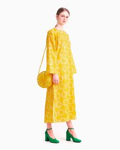 The Nektariini dress is made of thin cotton in the Appelsiini pattern. The dress has long sleeves that are dropped at the shoulder and a long slit at the back neckline, which features narrow bands that are tied together at the neck. The dress has a slight Marimekko Dress, Top Wedding Dresses, Yellow Fashion, Online Dress Shopping, Summer Looks, Dress Skirt, Kimono Top, Fashion Outfits, Female