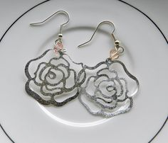 Sterling silver earrings. Filigree rose dangly earrings with dusty rose crystal bead.. $20.00, via Etsy.