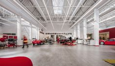 Former foundry as a car workshop, laboratory and museum. Lighting Concepts, Linear Lighting, Lighting System, Industrial Lighting, Lighting Solutions, Car Workshop, Retail Solutions, Storage Facility, Led Technology