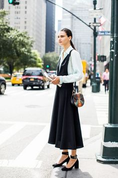 Love a black dress? We're rounding up plenty of outfit inspiration for pulling it off.