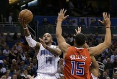 Orlando Magic guard Jameer Nelson (14) gets to the basket for a shot past Los Angeles Clippers' Ryan Hollins (15) during the first half of an NBA basketball game, Wednesday, Feb. 6, 2013, in Orlando, Fla.