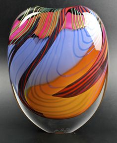 Peter Layton. London Glass Blowing. He went to Bradford Art College, then to London's Central School of Art and Design where he learned ceramics. In 1962 he attended a Harvey Littleton experimental workshop and learned his hot glass technique. About 1969 he established a small glass studio in the Scottish Highlands. In 1976 he formed London Glass Blowing, now in Bermondsey.