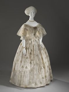 Ball gown, materials not listed (appears to metallic-brocaded silk satin trimmed with partially-metallic lace), c. 1850.