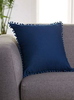 Kas Australia at Simons Maison. A delicate frame of little pompoms lends ultra trendy boho flair to this colourful cushion. A can't-miss detail this season! - Solid 100% cotton canvas - Washable with removable cover and a hidden zip on the edging - 45 x 45 cm