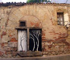 Pablo Sanchez Herrero paints trees on and in buildings. beautiful!