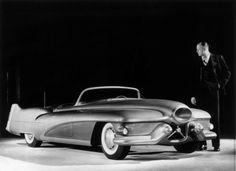 Harley J. Earl, designer for General Motors, standing next to the Buick Le Sabre test car, 1951