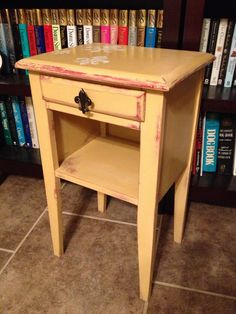 Little end table painted in Arles ASCP. I added a cute little Fleur de Lis knob on the drawer...This table was originally stained plain old brown, then painted red...then Arles...