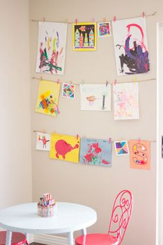 If your kids' art is scattered willy-nilly, use clothespins and twine to set up a creative display wall.