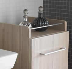 The mid-height base cabinet in the Mido range provides storage space and a practical shelf surface within reach of the washbasin.