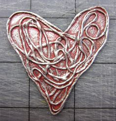 A Valentine Collage from Gelli Arts® & Winner of Tool of the Year at Creative World!  Here's how to make a heart like this one:    Run a fairly long piece of red thread through a small puddle of fabric stiffener. I used 6- strand embroidery floss and Fabric Stiffener by Crafter's Pick.  Arrange the thread to create a heart shape on a piece of freezer paper. Let it dry and harden. Then carefully remove it with a palette knife.