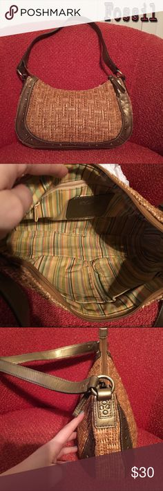Fossil hobo bag Super cute Fossil purse with woven body and gold leather trim. Outside is in great shape; inside does have some pen marks. Bag is stuffed and stored in a storage bag when not in use (dust bag not included). I would describe bag as a small to medium hobo. Fossil Bags Hobos