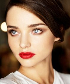 This perfect red pout adds punch to a neutral makeup palette. #classic #red #lips