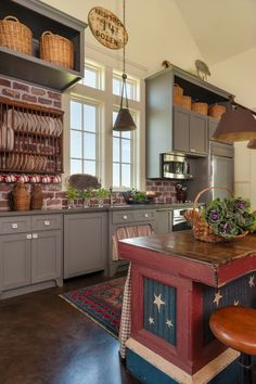 Love the color of these kitchen cabinets - and the brick backsplash eclecticallyvintage.com