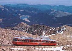 Pikes Peak, CO  I've been up it twice in a car and once on the Cog Railway.  I highly recommend the Cog.  Driving it is scary!