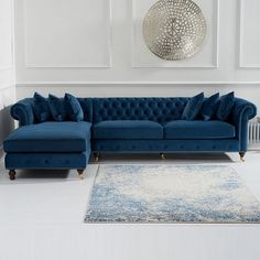 Nesta Chesterfield Left Corner Sofa In Blue Velvet And Wooden Legs, will gives an ultimate eye catchy look along with comfortable seating in any living space. Upholstered in Blue Velvet with Wooden. Living Room Decor Blue Sofa, Corner Sofa Living Room, Living Room Sofa Design, My Living Room, Living Room Designs, Blue Velvet Sofa Living Room, Living Area, Sofa Set Designs, Chesterfield Living Room