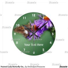 Painted Lady Butterfly On Aster Flower Round Clock.  From Smilin' Eyes Treasures at Zazzle.