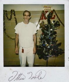 Photograph of serial killer Ottis Toole with a Christmas tree.