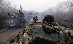 Tactical movements: a convoy of Ukrainian forces drives towards Debaltseve, part of heavy troop concentrations around the city.