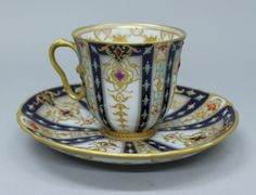 BERLIN KPM JEWELLED CUP AND SAUCER 19TH C.