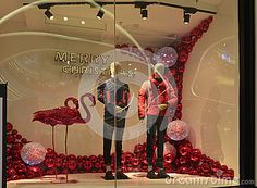 Merry Christmas clothing shop window,Winter fashion boutique display window with mannequins