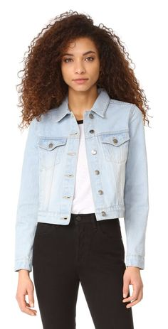 light up denim jacket by MINKPINK. A classic MINKPINK denim jacket in a faded wash. Fold over collar and button placket. Button tabs cinch the waist. Lo...