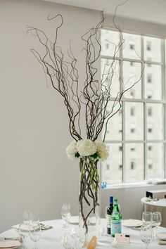 manzanite branch centerpiece - photo by Amber Gress Photography http://ruffledblog.com/stylish-manhattan-wedding