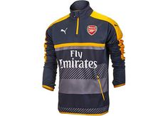 eebe5e5b667 Puma Arsenal 1 4 Zip Training Top - Ebony   Spectra Yellow - SoccerPro.com