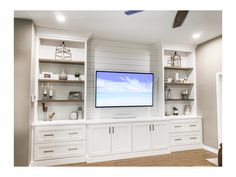 Custom built in entertainment center with shiplap back and stained shelves. Champagne Gold hardware to finish it off. Custom built in entertainment center with shiplap back and stained shelves. Champagne Gold hardware to finish it off. Built In Shelves Living Room, Bookshelves Built In, Living Room Tv, Home And Living, Basement Built Ins, Built In Tv Wall Unit, Custom Bookshelves, Custom Shelving, Bookcases