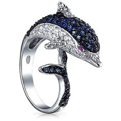 Bling Jewelry Bling Jewelry Rhodium Plated Blue And Clear Color Cz... ($45) ❤ liked on Polyvore featuring jewelry, rings, blue, sterling silver animal rings, cz cocktail rings, band rings, blue ring and cz rings