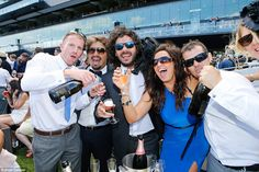A day off so why not get straight on it, race goers enjoying the day with some bubbles...