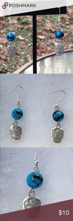 Turquoise Sugar Skull Earrings These cool earrings are made with reconstituted turquoise and silver tone sugar skull charms. The hooks are sterling silver plated.   All PeaceFrog jewelry items are handmade by me! Take a look through my boutique for coordinating jewelry and more unique creations. PeaceFrog Jewelry Earrings
